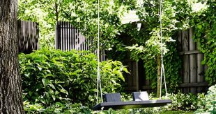 Bluestone pavers lead to a handmade garden swing, tucked into a shady corner. #g...